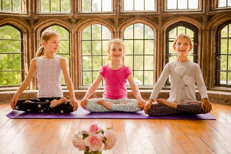 children practicing yoga