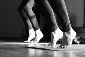 feet of people doing yoga